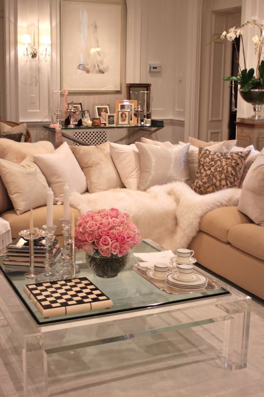 romantic feminine living room taupe beige sofa glass coffee table mirror chess set decor decorative urban hollywood home