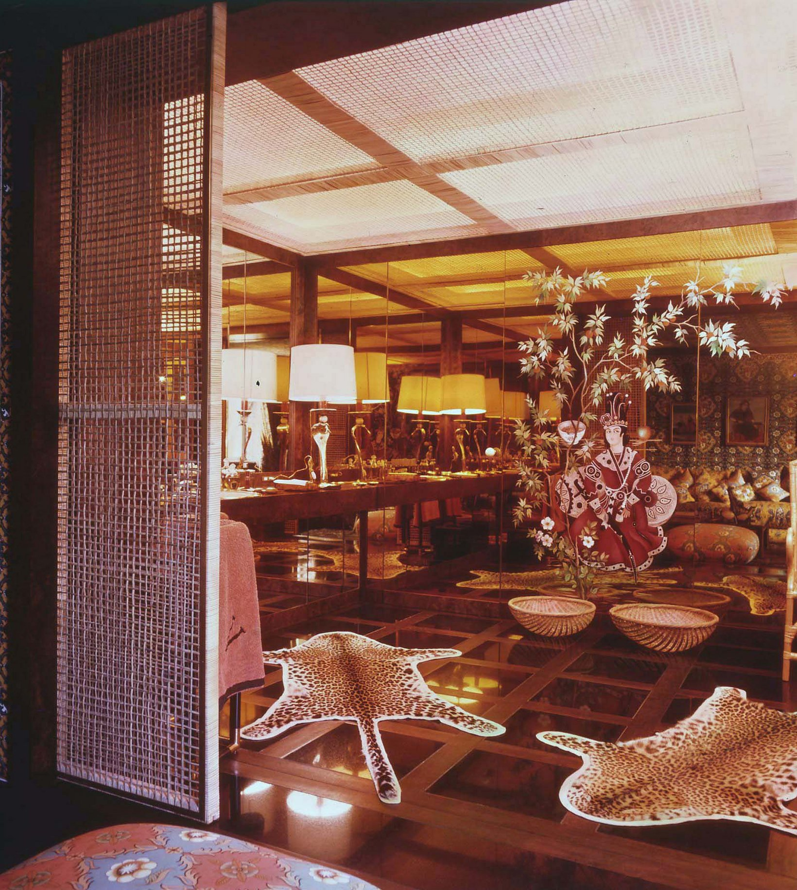 Sao Schlumberger paris home 1974 leopard print washroom bathroom master bath asian mirrored chome inspired gold mirror rug shop room ideas celebrity tour ideas