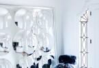 art deco inspired georgian home mansion sheepskin chair stool blue navy dark moody interior inspiration shop room ideas entrance all white mirror