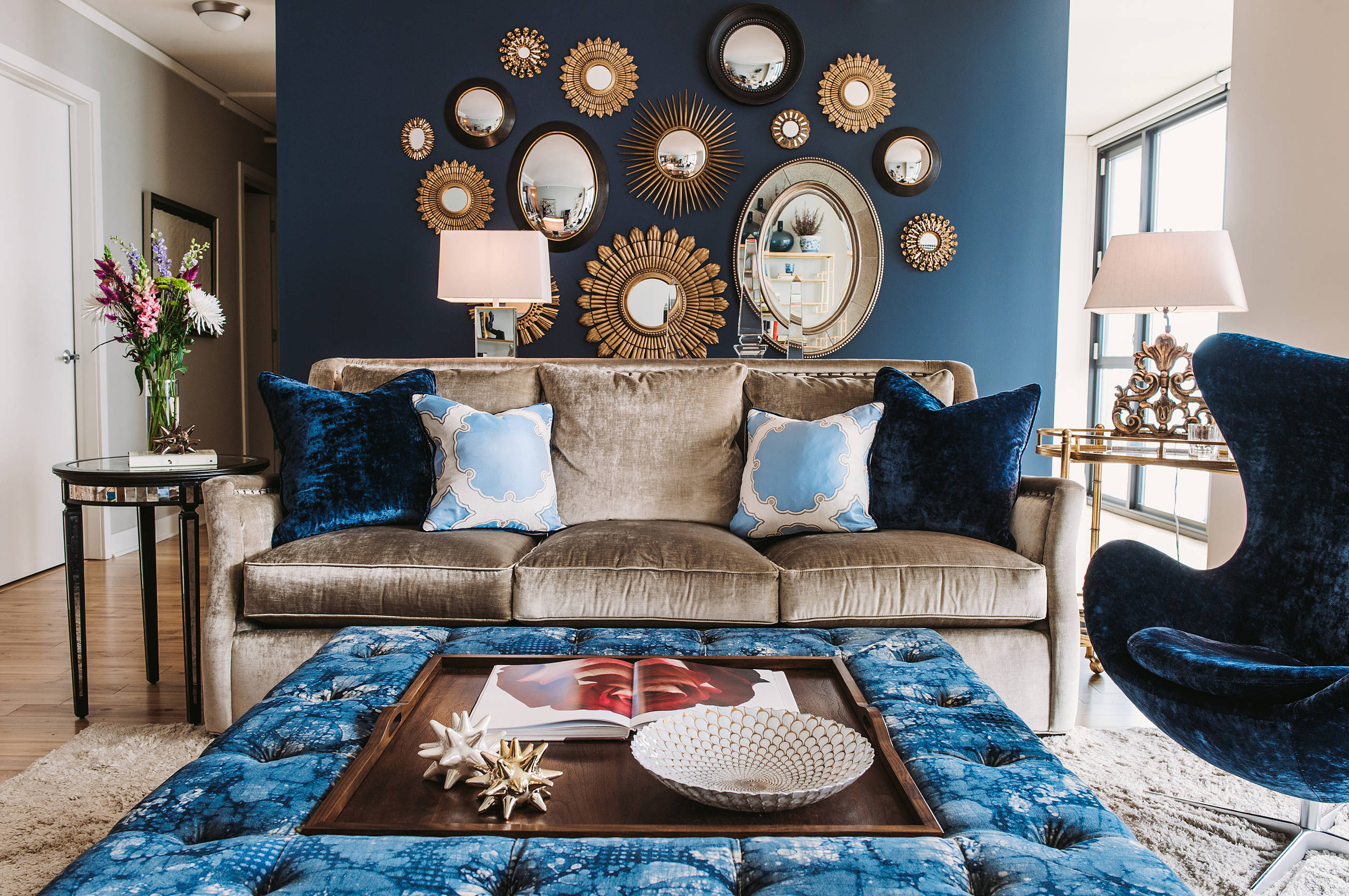 transitional-living-room inspiration condo ideas silver velvet navy blue cuch mirror gallery wall shop room ideas grouping pillow arrange