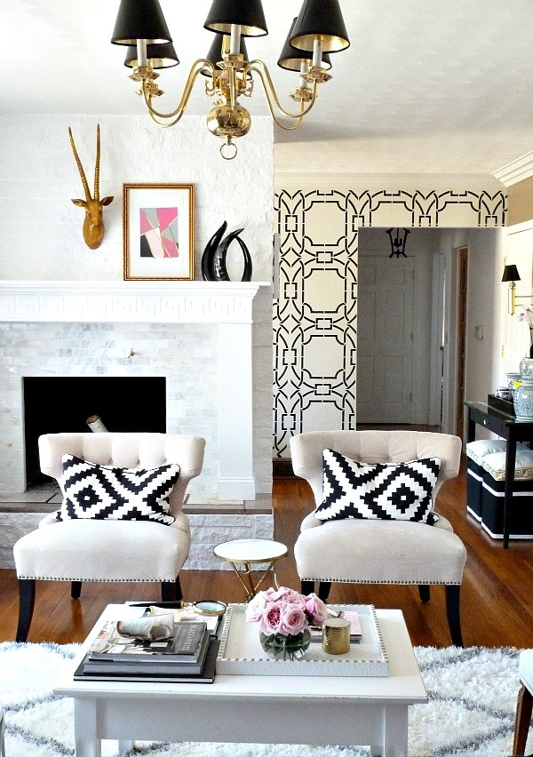 greek-key-abstract-print-pillow-black-and-white-family-room-chandelier-design-inspiration-sophisticated-modern-girly-eclectic-marble-fireplace-geometric-wallpaper-shop-room-ideas