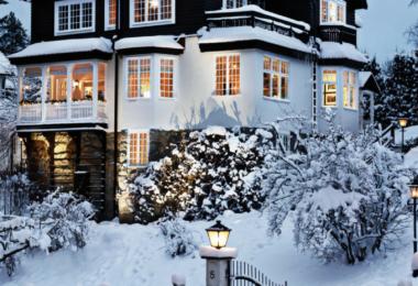 scandinavian-swedish-christmas-house-tour-home-style-exterior-design-ideas-inspiration-snow-cottage-porch-wreath-interior-design-mountain-patio-gate-wood-picket-fence-wood-facade