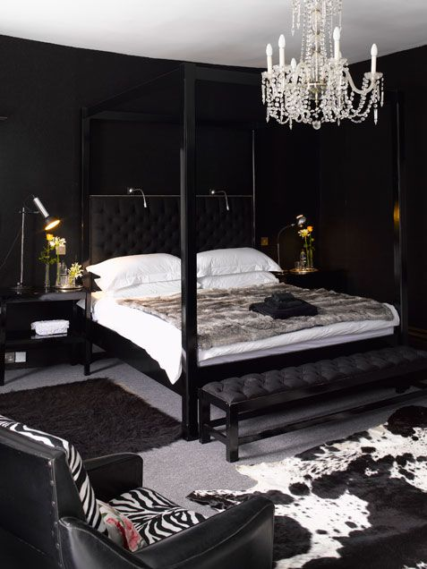 black and white master bedrrom design inspiration decor black walls 4 four poster bed calfskin carpet zebra chairs all black bedroom modern luxury style apartment king bed
