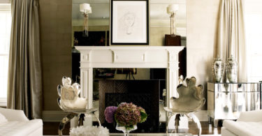 glass reflective tile fireplace mantle backsplash cream beige and white living room idea inspiration rustic country glam glass clear ghost square coffee table furniture traditional decor house ideas