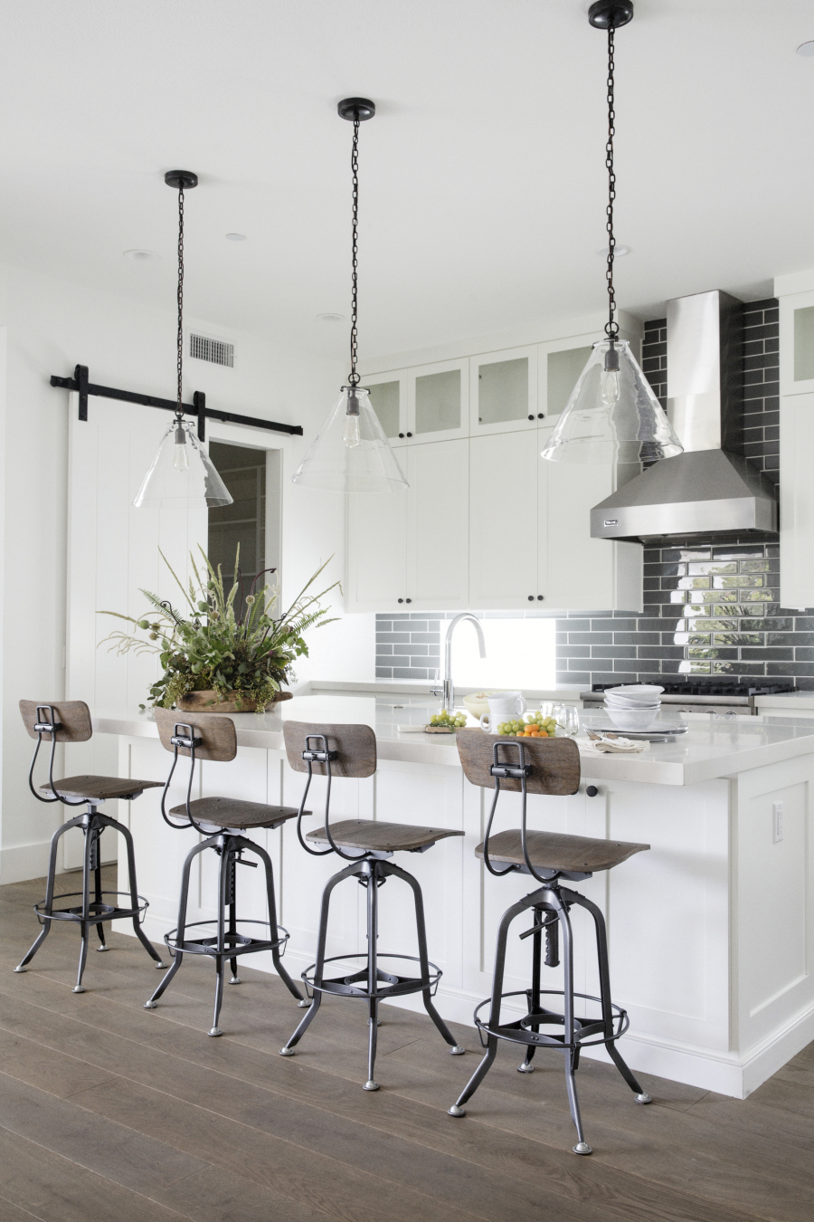 white farmhouse with vintage wood and metal barstool vinyl flooring hardwood dieas sliding barn door pantry grey subway backsplash white kitchen glas lantern chandelier shop room ideas
