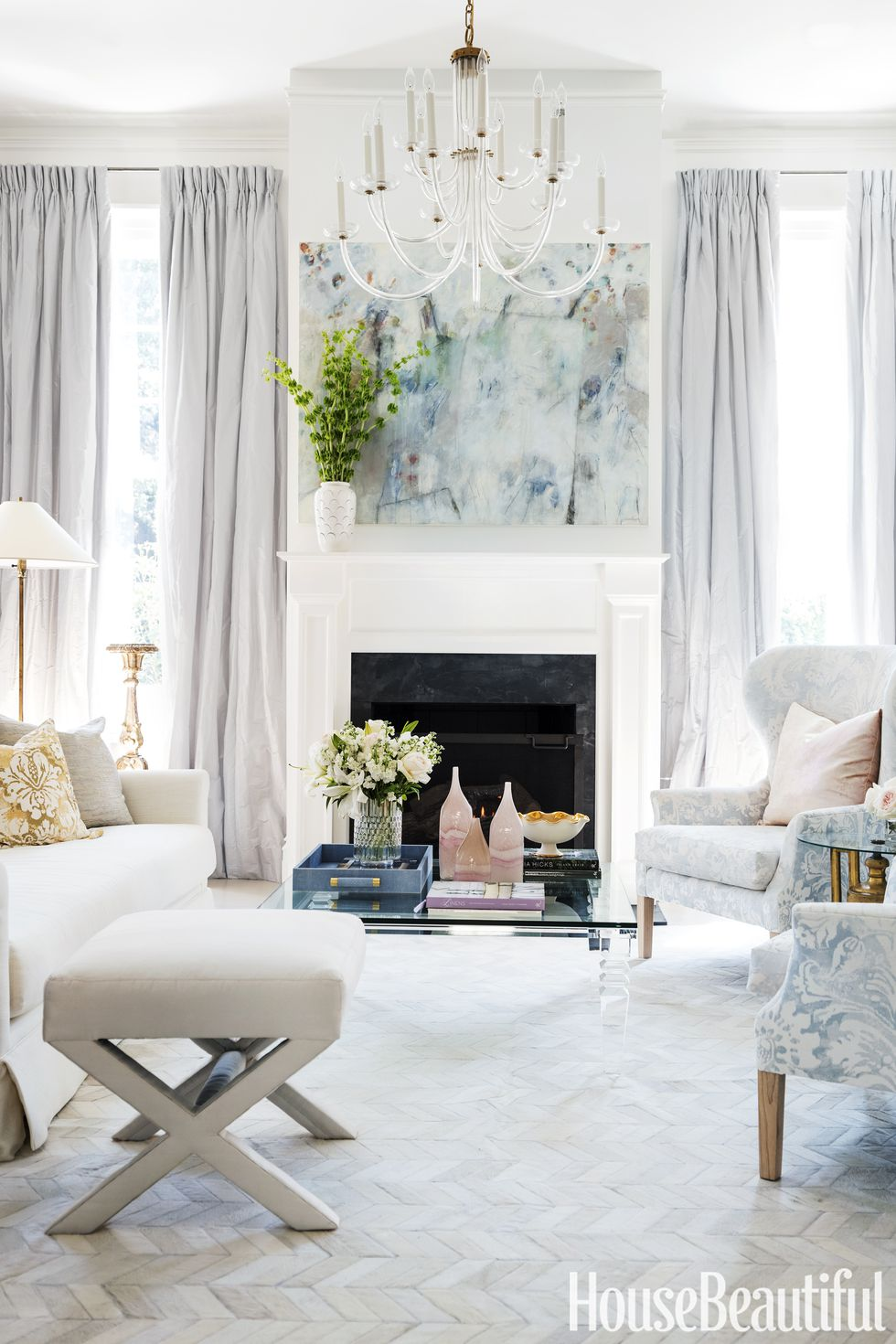 all white living room fireplace middle with painting chevron tiles woven carpet damasque print chair sofa fabric glam contemporary shop room ideas