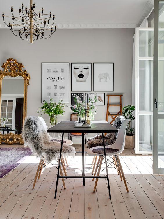 french parisian apartment gold mirror leaning wall scandinavian chairs modern look apartment loft light hardwood floors