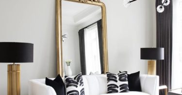 gold glamorous mirror vintage french style paris apartment high ceilings modern chandelier black white gold leaf decor minimalistic modern minimal zebra black marble square coffee table