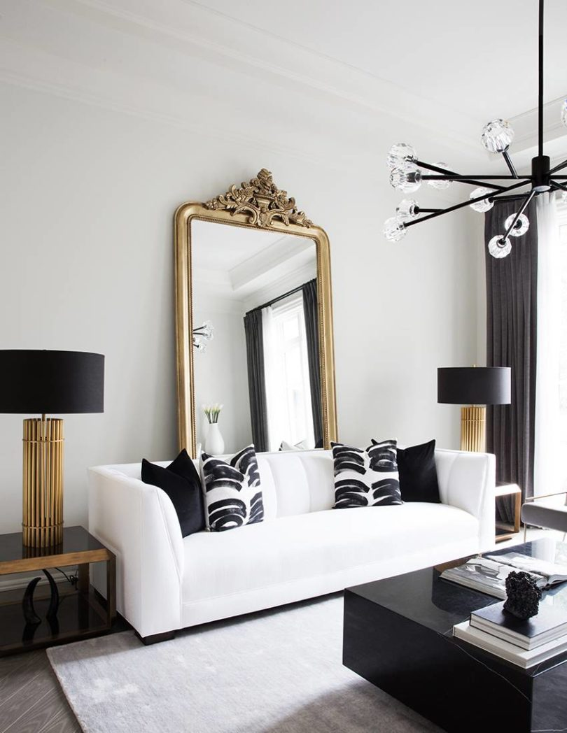 Gold glamorous mirror vintage french style paris apartment high ceilings modern chandelier black white gold leaf
