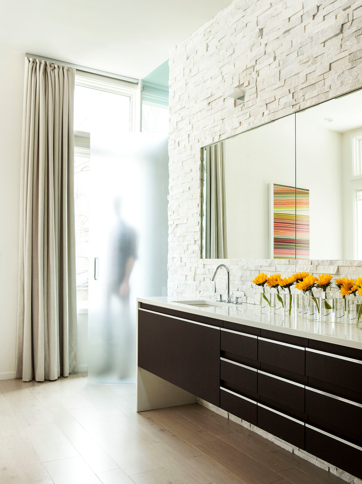 contemporary-bathroom white stone wall accent ideas modern bathroom dark vanity light white countertop frosted glass transitional