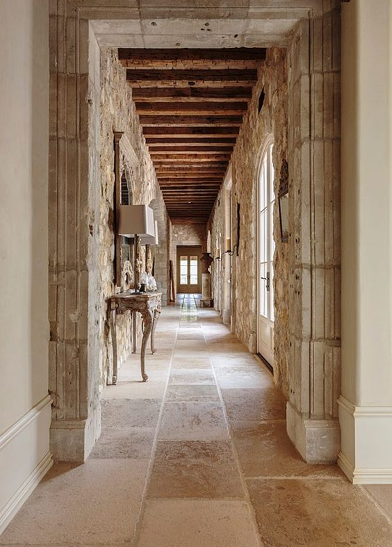 rustic natural neutral stone wall and floor indoor outdoor tile rustic country italian french cottage ski lodge style inspiration entry way hallway with stone accent wall