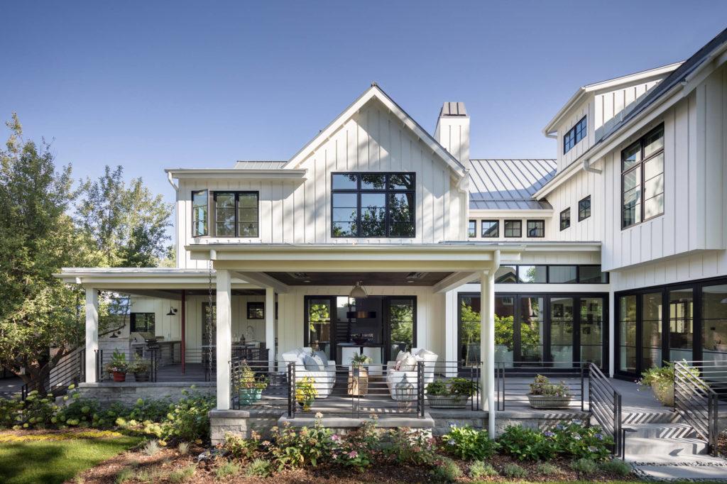 farmhouse-exterior home maintenance tips guttering modern farm style aluminum siding backyard horse farm white and black modern